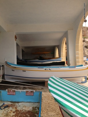 Boats docked near The Blue Grotto